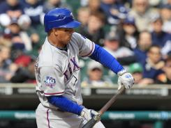 With the bases loaded and nobody out, the Rangers' Alberto Gonzalez bunted back to Tigers pitcher Thad Weber, who had no play at the plate on runner Nelson Cruz.