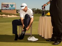 Ben Curtis dons a pair of ceremonial cowboy boots after winning the Valero Texas Open on Sunday at the AT&T Oaks Course at TPC San Antonio.