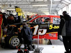 The No. 15 Toyota driven by Clint Bowyer gets a look in the garage during Sunday's race at Kansas Speedway. Bowyer was one of many drivers with engine troubles.