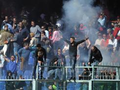 Angry Genoa fans delayed the tam's match 45 minutes after throwing flares onto the pitch.