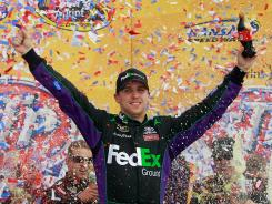 Denny Hamlin celebrates his second victory of the season after Sunday's STP 400 at Kansas Speedway. Hamlin and Tony Stewart each have two wins in 2012.