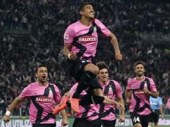 Arturo Vidal celebrates one of his two goals that helped Juventus remain unbeaten.
