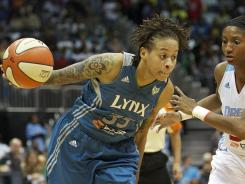 Minnesota Lynx guard Seimone Augustus (33) drives the ball past Atlanta Dream guard Angel McCoughtry (35) during the WNBA Finals at Philips Arena on Oct. 7, 2011.