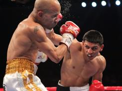 Abner Mares, right, punished Eric Morel Saturday night with powerful body shots, and straight rights that at times staggered Morel.