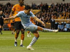 Samir Nasri punches in a 74th-minute goal to secured Manchester City's 2-0 win.