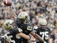 Purdue running back Ralph Bolden, right, reacts with running back Dan Dierking after Bolden scored on a 3-yard touchdown run during the second quarter of a game against Illinois in West Lafayette, Ind., Saturday, Oct. 24, 2009.