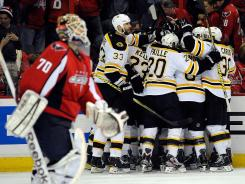 The Bruins forced a deciding game when Tyler Seguin won Game 6 with an overtime goal by Braden Holtby, left.