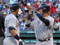 Alex Rodriguez, left, hit his 632rd career homer and Derek Jeter extended his hitting streak to 13 games to lead the Yankees to their fourth consecutive win.