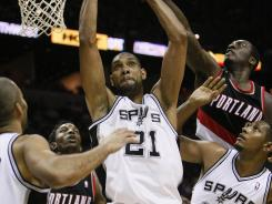 Tim Duncan (21) pulls down one of his eight rebound against the Trail Blazers as he and the Spurs clinched the No. 1 seed in the West for the sixth time in Duncan's tenure.
