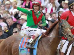 John Velazquez poses after riding Animal Kingdom to victory at the Kentucky Derby last year. Velazquez was elected to the National Museum of Racing's Hall of Fame on Monday.