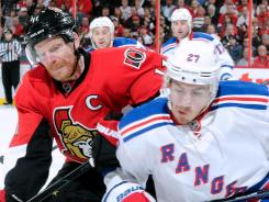 Ottawa captain Daniel Alfredsson, left, chases the puck in the corner in Game 6.