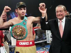 Julio Cesar Chavez Jr, with his promoter, Bob Arum, after Chavez defeated Peter Manfredo Jr. last November.