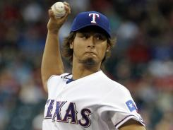 Facing the Yankees for the first time, Yu Darvish pitched into the ninth inning on Tuesday, earning the win for the Rangers.