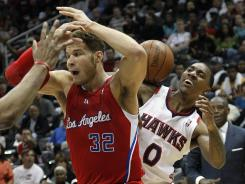 Atlanta guard Jeff Teague (0) and Los Angeles forward Blake Griffin (32) battle for a loose ball in the second half of the Hawks' 109-102 win over the Clippers on Tuesday night.