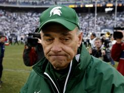 John L. Smith, shown here on Nov. 18, 2006 with Michigan State, has compiled a 132-86 career record in 18 combined seasons at Idaho, Utah State, Louisville and Michigan State.