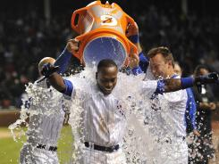 Cubs left fielder Alfonso Soriano gets doused in Gatorade by his teammates after getting a walk-off hit against the Cardinals Tuesday.