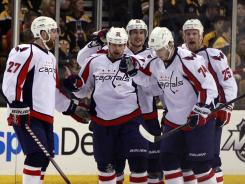 Capitals center Matt Hendricks, center, gets kudos from his Washington teammates after scoring a first-period goal, his first of the series.