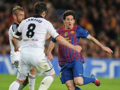 Barcelona's Lionel Messi, right, vies fot the ball with Chelsea's Raul Meireles and Frank Lampard during the UEFA Champions League semifinal match in Barcelona on Tuesday.