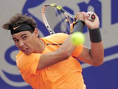 Rafael Nadal of Spain smashes a backhand during his victory Wednesday against compatriot Guillermo Garcia-Lopez.