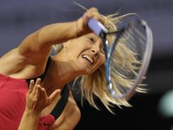 Maria Sharapova of Russia serves up a victory Wednesday against Alize Cornet at the WTA Porsche Tennis Grand Prix in Stuttgart, Germany.