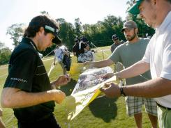 Bubba Watson signs autographs Wednesday ahead of the Zurick Classic of New Orleans.