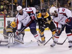 Washington Capitals right wing Joel Ward scores the game-winning goal against the Boston Bruins.