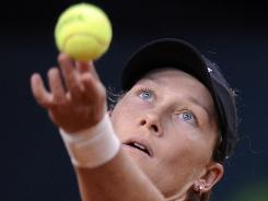 Samantha Stosur of Australia winds up to serve during her victory Thursday against Julia Goerges of Germany in the Porsche Grand Prix in Stuttgart, Germany.