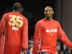 Kevin Durant, left, will win his third NBA scoring title in a row, just edging Western All-Star Game teammate Kobe Bryant, right.