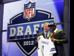 Morris Claiborne, right, was taken by the Dallas Cowboys after they traded up to the No. 6 spot.