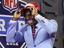 Baylor quarterback Robert Griffin III walks on stage after he was selected as the No. 2 overall pick by the Washington Redskins Thursday in the NFL draft.