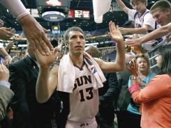 Steve Nash slaps hands with fans in possibly his last game with the Phoenix Suns on Wednesday.