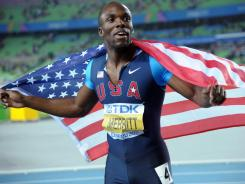 LaShawn Merritt takes a victory lap with a United States flag after finishing second in the 400 meters in 44.63 seconds at the 2011 IAAF World Championships in Daegu, South Korea, on Aug. 30.