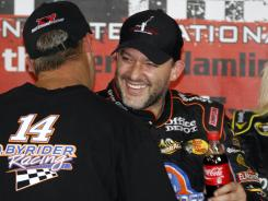 Tony Stewart celebrates winning the Denny Hamlin Short Track Showdown charity race on Thursday.