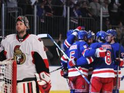 Ottawa goalie Craig Anderson reacts as Dan Girardi and teammates celebrate his second-period goal.