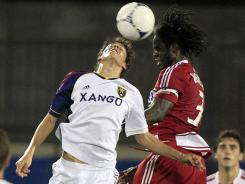 Emiliano Bonfigli of Real Salt Lake (12) vies for a header against Ugo Ihemelu of FC Dallas (3).
