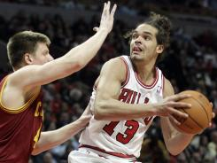Chicago center Joakim Noah, right, looks to the basket as Cleveland forward Luke Harangody guards during the Bulls 107-75 victory over the Cavaliers on Thursday at Chicago.
