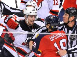 Officials separate Florida Panthers right wing Scottie Upshall (19) and New Jersey Devils center Adam Henrique (14) in the second period of Game 7 at Sunrise, Fla., on Thursday.