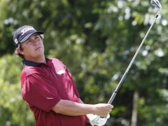 Jason Dufner hits a tee shot on the 14th hole during the second round of the Zurich Classic at the TPC Louisiana course in Avondale, La. on Friday. Dufner emerged with the second-round lead.
