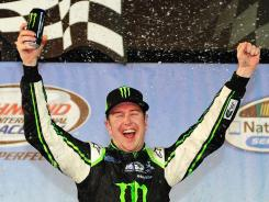 Kurt Busch, driver of the #54 Monster Energy Toyota, celebrates in Victory Lane after winning the NASCAR Nationwide Series at Richmond International Raceway on Richmond, Va., on Friday.