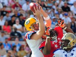 Aaron Rodgers, left, tries to bat down a ball during January's Pro Bowl, a rare show of competitiveness in the game.