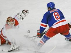 Washington Capitals goaltender Braden Holtby makes a save against the New York Rangers' Brandon Prust on April 7.