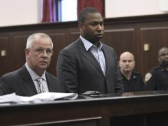 Tigers' Delmon Young, center, accompanied by his attorney, is arraigned in Manhattan criminal court.