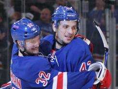 The New York Rangers Artem Anisimov celebrates his second-period goal with teammate Anton Stralman in the second period of Game 1 of the Eastern Conference semifinals against the Washington Capitals at Madison Square Garden in New York City.