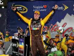 NASCAR Sprint Cup driver Kyle Busch (18) celebrates after winning the Capital City 400 at Richmond International Raceway.