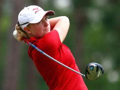 Stacy Lewis tees off the ninth hole during the third round of the Mobile Bay LPGA Classic in Mobile, Ala. Lewis has a two-stroke lead over the pack heading into the final round of play.