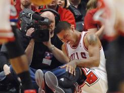 The Chicago Bulls' playoff fortunes took a hit Saturday when All-Star point guard Derrick Rose was lost for the postseason with a tear of his left knee anterior cruciate ligament.