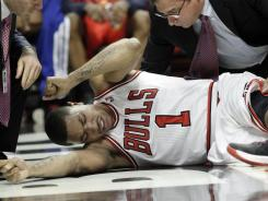 Chicago Bulls guard Derrick Rose was leading the team to victory Saturday vs. the Philadelphia 76ers until a left leg injury with just over a minute left in the game.