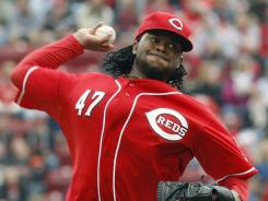 Cincinnati Reds starting pitcher Johnny Cueto throws against the Houston Astros. Cueto, who is now 3-0, shutout the Astros as the Reds went on to win 6-0.