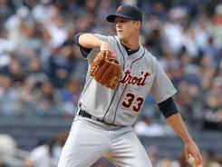 Detroit Tigers starting pitcher Drew Smyly delivers a pitch during the first inning of a game against the New York Yankees. Smyly led the Tigers to a 7-5 win, his first in the majors.