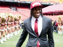 New Redskins QB Robert Griffin III is introduced to the fans at FedEx Field on Saturday.